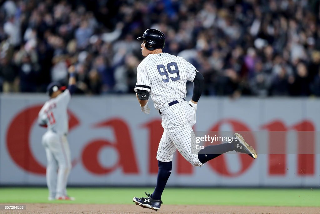 Aaron Judge #99 of the New York Yankees rounds the bases after hitting a two run home run against Jose Berrios #17 of the Minnesota Twins during the fourth inning in the American League Wild Card Game at Yankee Stadium on October 3, 2017 in the Bronx borough of New York City.