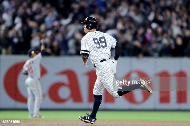 Aaron Judge of the New York Yankees rounds the bases after hitting a two run home run against Jose Berrios of the Minnesota Twins during the fourth...