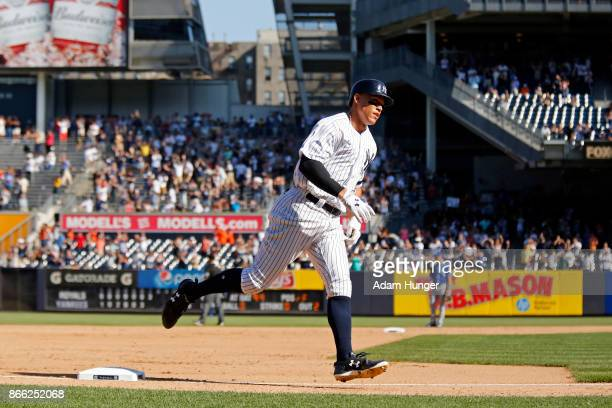 Aaron Judge of the New York Yankees rounds the bases after hitting a solo home run against the Kansas City Royals during the seventh inning at Yankee...