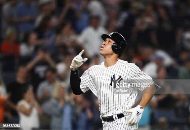 Aaron Judge of the New York Yankees rounds the bases after hitting a home run against Charlie Morton of the Houston Astros in the fifth inning during...