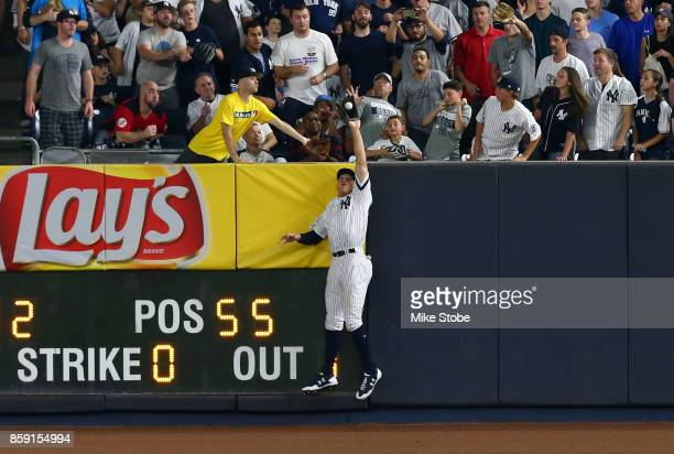 Aaron Judge of the New York Yankees saves a home run with a catch of a deep fly ball during the sixth inning against the Cleveland Indians in game...
