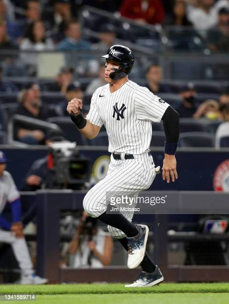 Aaron Judge of the New York Yankees scores a run in the third inning against the Texas Rangers at Yankee Stadium on September 20, 2021 in New York...