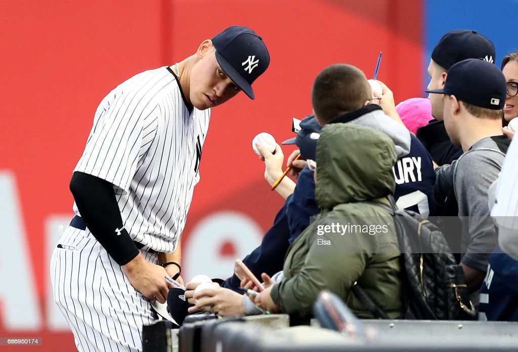 Aaron Judge #99 of the New York Yankees signs autographs before the game against the Kansas City Royals on May 22, 2017 at Yankee Stadium in the Bronx borough of New York City.