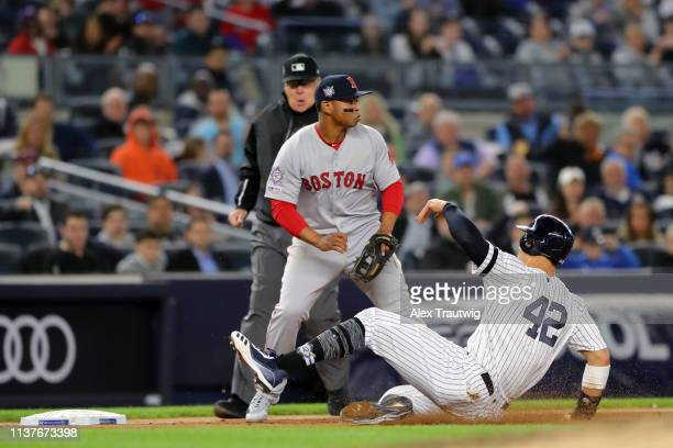 Aaron Judge of the New York Yankees slides safely into third base in the fifth inning during the game between the Boston Red Sox and the New York...