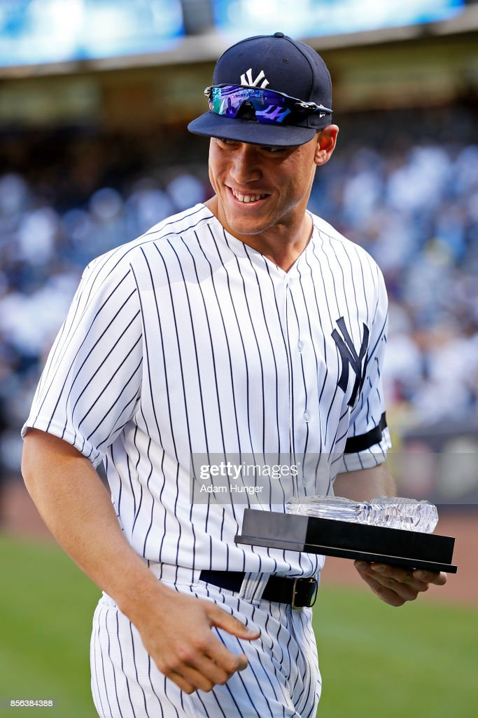 Aaron Judge of the New York Yankees smiles with a crystal gavel he was presented before the Yankees final regular season baseball game against the Toronto Blue Jays at Yankee Stadium on October 1, 2017 in the Bronx borough of New York City.