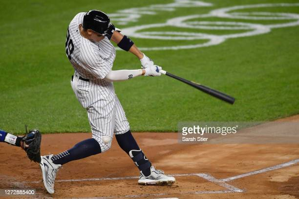 Aaron Judge of the New York Yankees strikes out swinging in his first at-bat after coming off the IL during the first inning against the Toronto Blue...