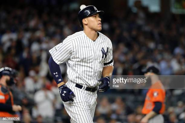 Aaron Judge of the New York Yankees takes first base after a walk during the fifth inning against the Houston Astros in Game Five of the American...