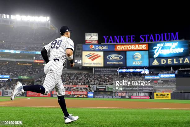 Aaron Judge of the New York Yankees takes the field prior to the start of Game Three of the American League Division Series against the Boston Red...
