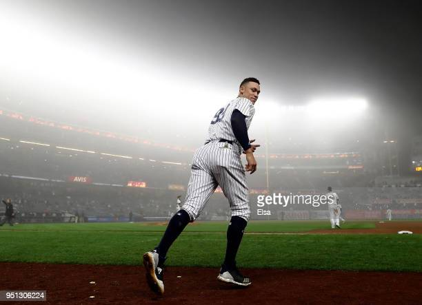Aaron Judge of the New York Yankees takes the field to start the ninth inning against the Minnesota Twins at Yankee Stadium on April 25 2018 in the...