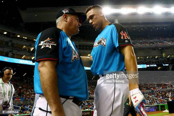Aaron Judge of the New York Yankees talks with Danilo Valiente during the 2017 TMobile Home Run Derby at Marlins Park on Monday July 10 2017 in Miami...