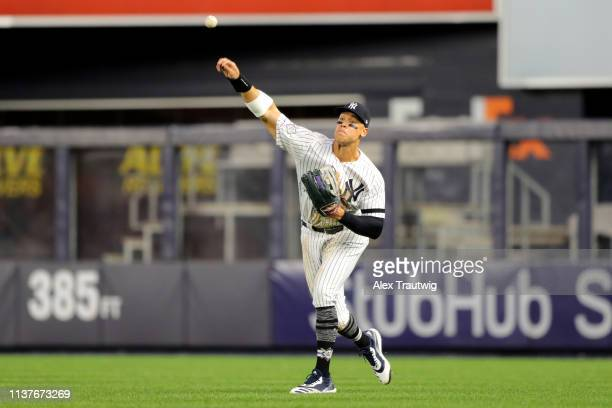 Aaron Judge of the New York Yankees throws the ball back to the infield during the game between the Boston Red Sox and the New York Yankees at Yankee...