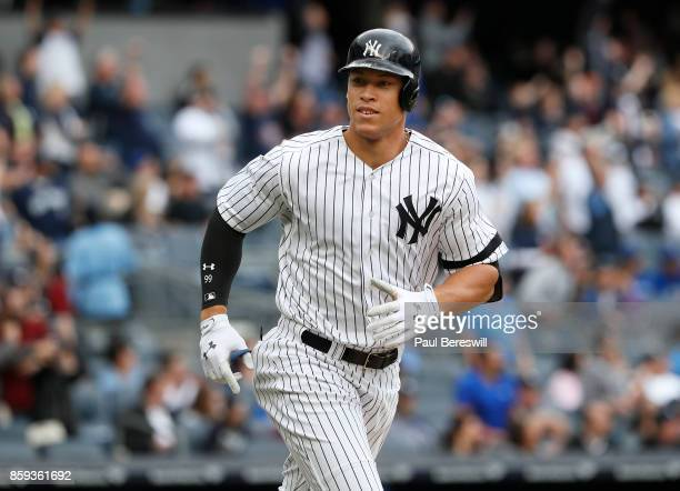 Aaron Judge of the New York Yankees tosses his bat and starts his run around the bases while looking to his dugout after hitting his 52nd home run of...