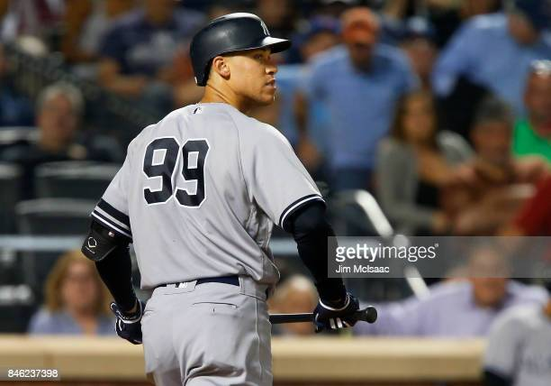 Aaron Judge of the New York Yankees walks back to the dugout after striking out to end the eighth inning against the Tampa Bay Rays at Citi Field on...