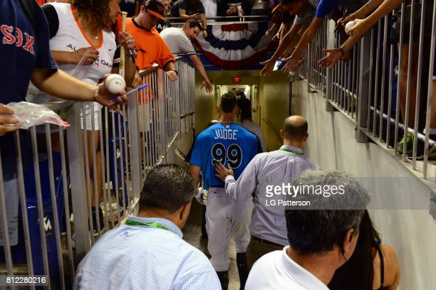 Aaron Judge of the New York Yankees walks backs into the clubhouse after winning the the 2017 TMobile Home Run Derby at Marlins Park on Monday July...