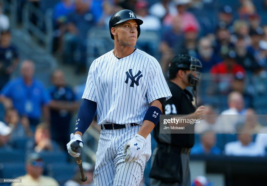 Aaron Judge #99 of the New York Yankees walks off the field after striking out to end the first game of a doubleheader against the Cleveland Indians at Yankee Stadium on August 30, 2017 in the Bronx borough of New York City.