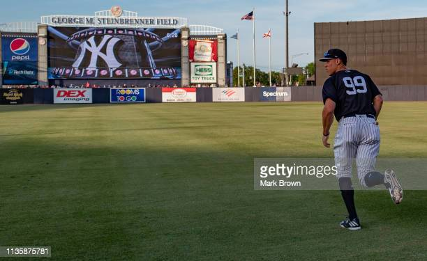 Aaron Judge of the New York Yankees warms up before the spring training game against the Philadelphia Phillies at Steinbrenner Field on March 13 2019...