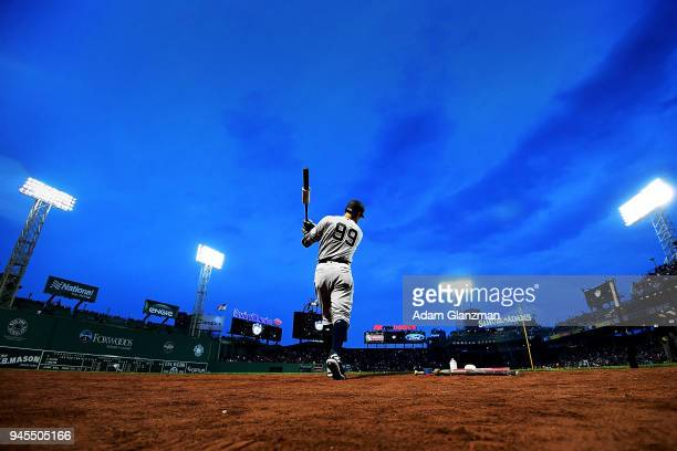 Aaron Judge of the New York Yankees warms up in the on deck circle before a game against the Boston Red Sox at Fenway Park on April 12 2018 in Boston...