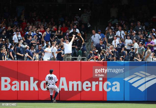 Aaron Judge of the New York Yankees watches a three run home run go over the fence hit by Domingo Santana of the Milwaukee Brewers in the first...