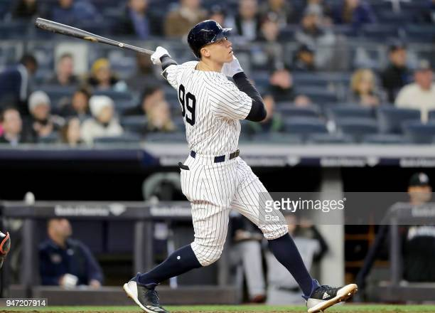 Aaron Judge of the New York Yankees watches his solo home run in the second inning against the Miami Marlins at Yankee Stadium on April 16 2018 in...