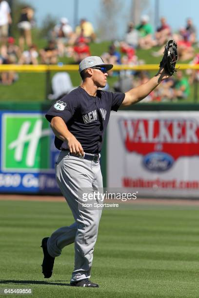 Aaron Judge of the Yankees hustles over to near the foul line to make a catch during the spring training game between the New York Yankees and the...