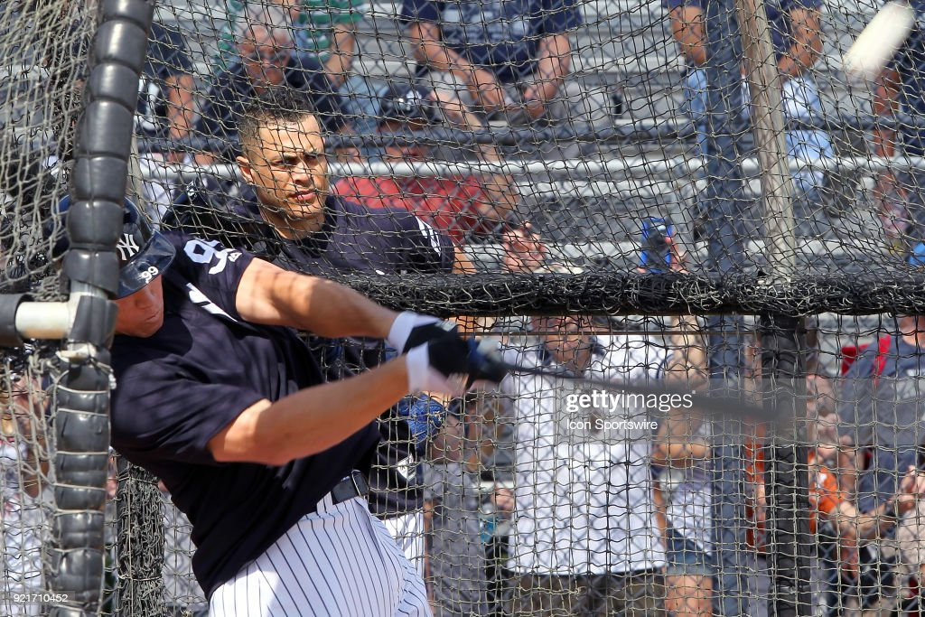 Aaron Judge (99) takes a swing during batting practice as Giancarlo Stanton (27) looks on during the New York Yankees spring training workout on February 20, 2018, at George M. Steinbrenner Field in Tampa, FL.