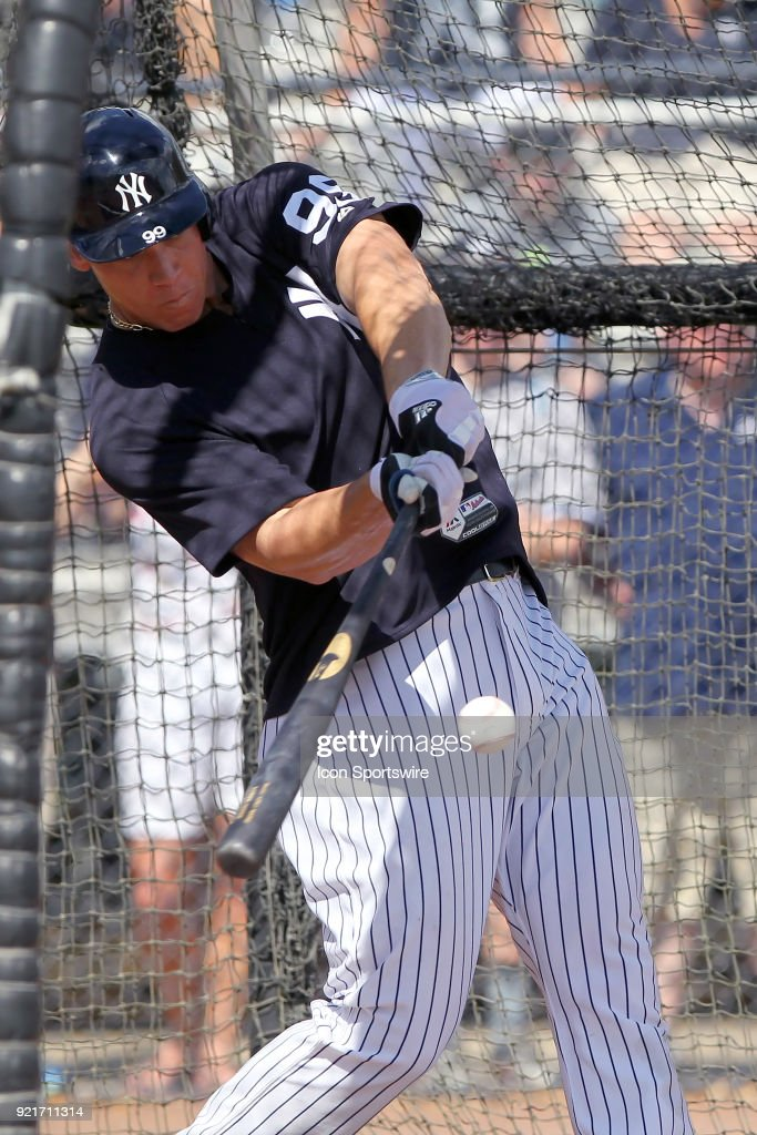 Aaron Judge (99) takes a swing while in the batting cage during the New York Yankees spring training workout on February 20, 2018, at George M. Steinbrenner Field in Tampa, FL.