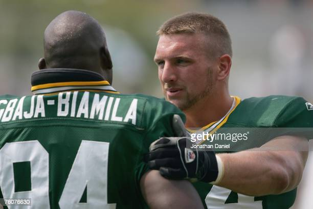 Aaron Kampman of the Green Bay Packers works out with teammate Kabeer GbajaBiamila during summer training camp on August 6 2007 at the Hutson Center...