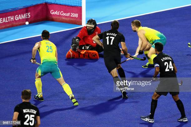 Aaron Kleinschmidt of Australia scores his sides first goal in the Men's gold medal match between Australia and New Zealand during Hockey on day 10...
