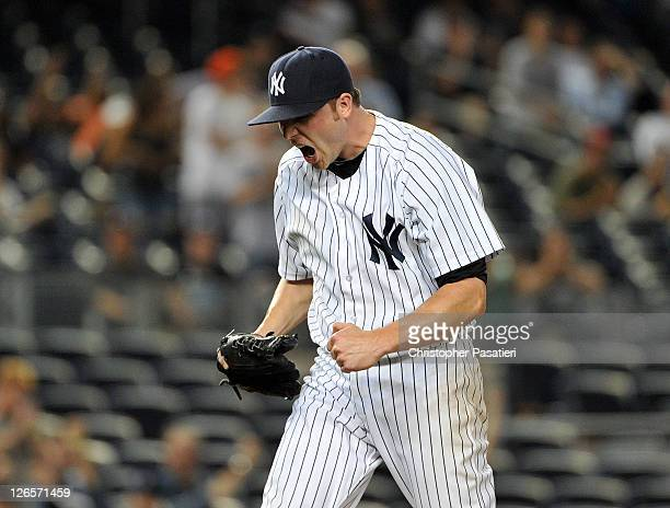 Aaron Laffey of the New York Yankees reacts after striking out Lars Anderson of the Boston Red Sox to end the top of the 13th inning against the...