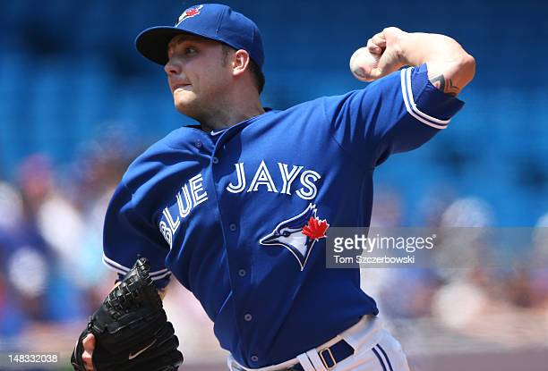 Aaron Laffey of the Toronto Blue Jays delivers a pitch during MLB game action against the Cleveland Indians on July 14 2012 at Rogers Centre in...