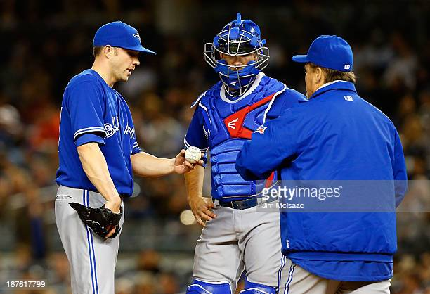 Aaron Laffey of the Toronto Blue Jays hands the ball to manager John Gibbons as he leaves the game against the New York Yankees in the third inning...