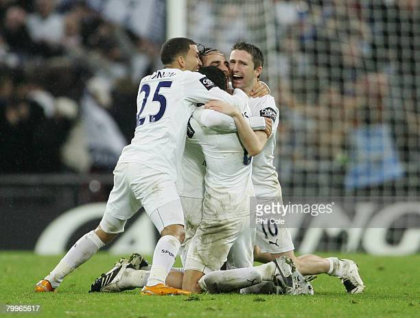 Aaron Lennon Dimitar Berbatov Jermaine Jenas and Robbie Keane of Tottenham Hotspur celebrate victory following the Carling Cup Final between...