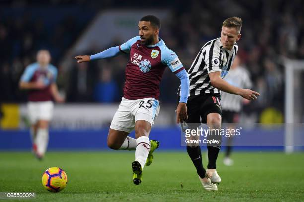 Aaron Lennon of Burnley evades Matt Ritchie of Newcastle United during the Premier League match between Burnley FC and Newcastle United at Turf Moor...