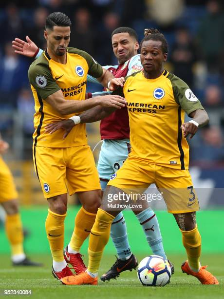 Aaron Lennon of Burnley is blocked by Biram Kayal and Gaetan Bong of Brighton and Hove Albion during the Premier League match between Burnley and...