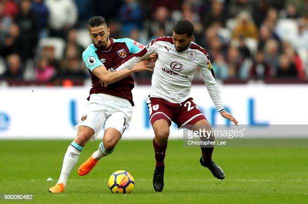 Aaron Lennon of Burnley is challenged by Manuel Lanzini of West Ham United during the Premier League match between West Ham United and Burnley at...