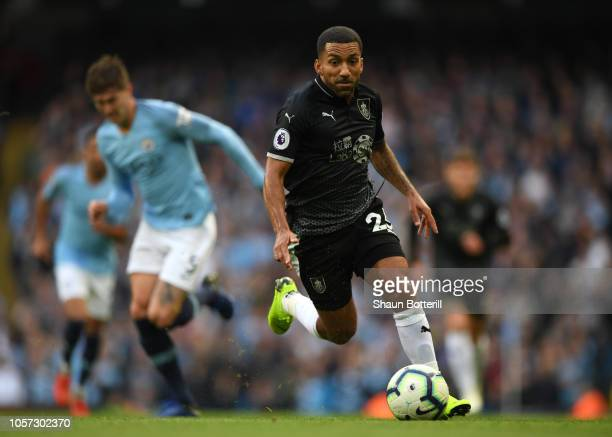 Aaron Lennon of Burnley runs with the ball during the Premier League match between Manchester City and Burnley FC at Etihad Stadium on October 20...