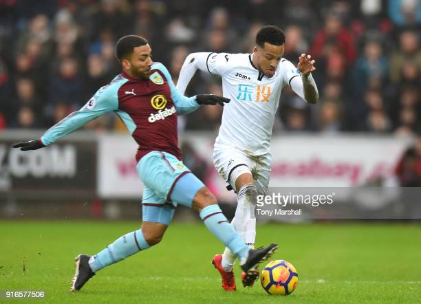 Aaron Lennon of Burnley tackles Martin Olsson of Swansea City during the Premier League match between Swansea City and Burnley at Liberty Stadium on...