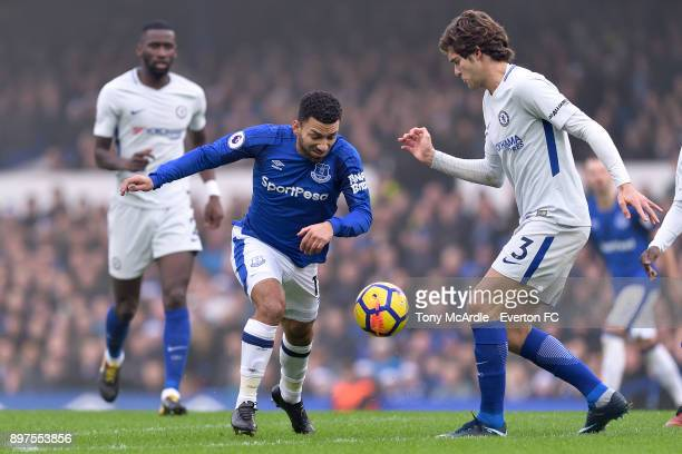 Aaron Lennon of Everton and Marcos Alonso challenge for the ball during the Premier League match between Everton and Chelsea at Goodison Park on...