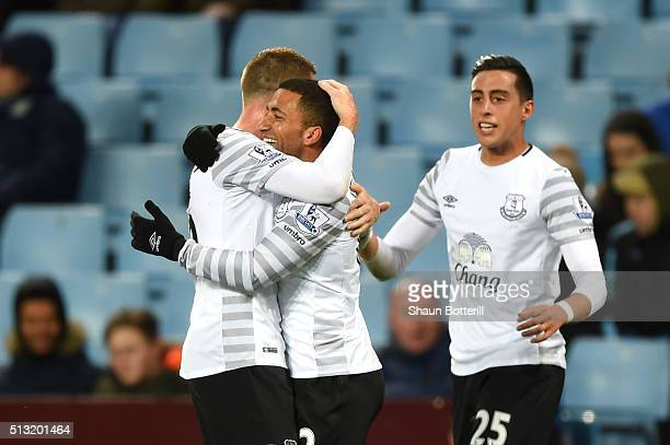 Aaron Lennon of Everton celebrates scoring his team's second goal with his team mates during the Barclays Premier League match between Aston Villa...
