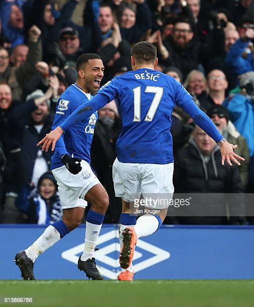 Aaron Lennon of Everton celebrates scoring his team's second goal with his team mate Muhamed Besic during the Barclays Premier League match between...