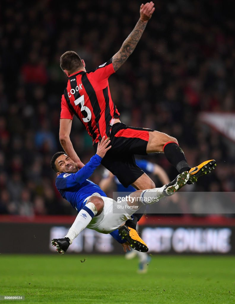 Aaron Lennon of Everton is challenged by Steve Cook of Bournemouth during the Premier League match between AFC Bournemouth and Everton at Vitality Stadium on December 30, 2017 in Bournemouth, England.