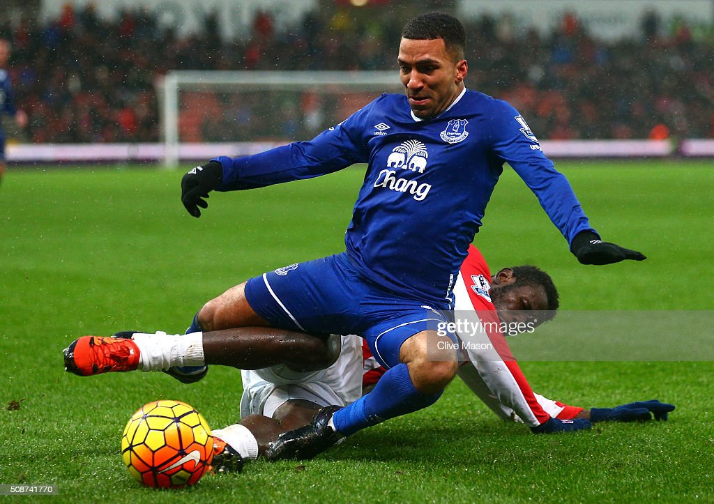 Aaron Lennon of Everton is tackled by Mame Biram Diouf of Stoke City during the Barclays Premier League match between Stoke City and Everton at Britannia Stadium on February 6, 2016 in Stoke on Trentl, England.