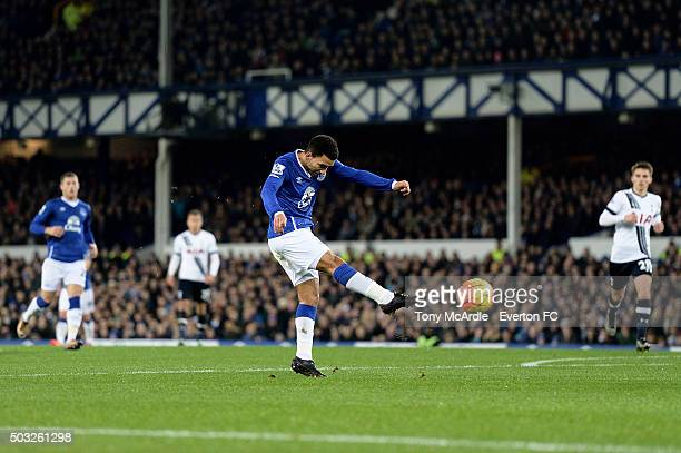 Aaron Lennon of Everton shoots to score the opening goal during the Barclays Premier League match between Everton and Tottenham Hotspur at Goodison...