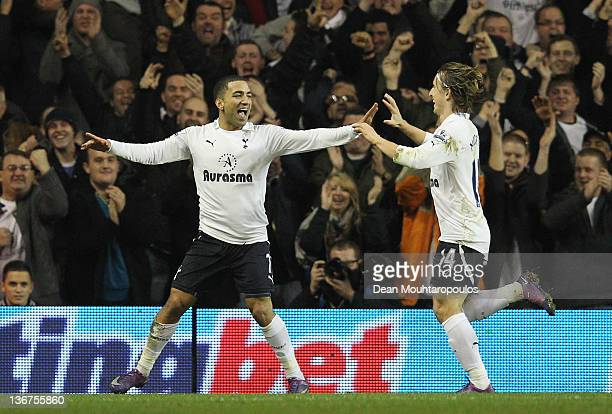 Aaron Lennon of Spurs celebrates scoring the opening goal with team mate Luka Modric of Spurs during the Barclays Premier League match between...