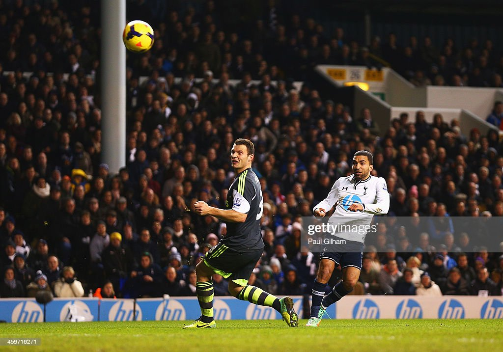 Aaron Lennon of Tottenham Hotspur scores his team's third goal during the Barclays Premier League match between Tottenham Hotspur and Stoke City at White Hart Lane on December 29, 2013 in London, England.