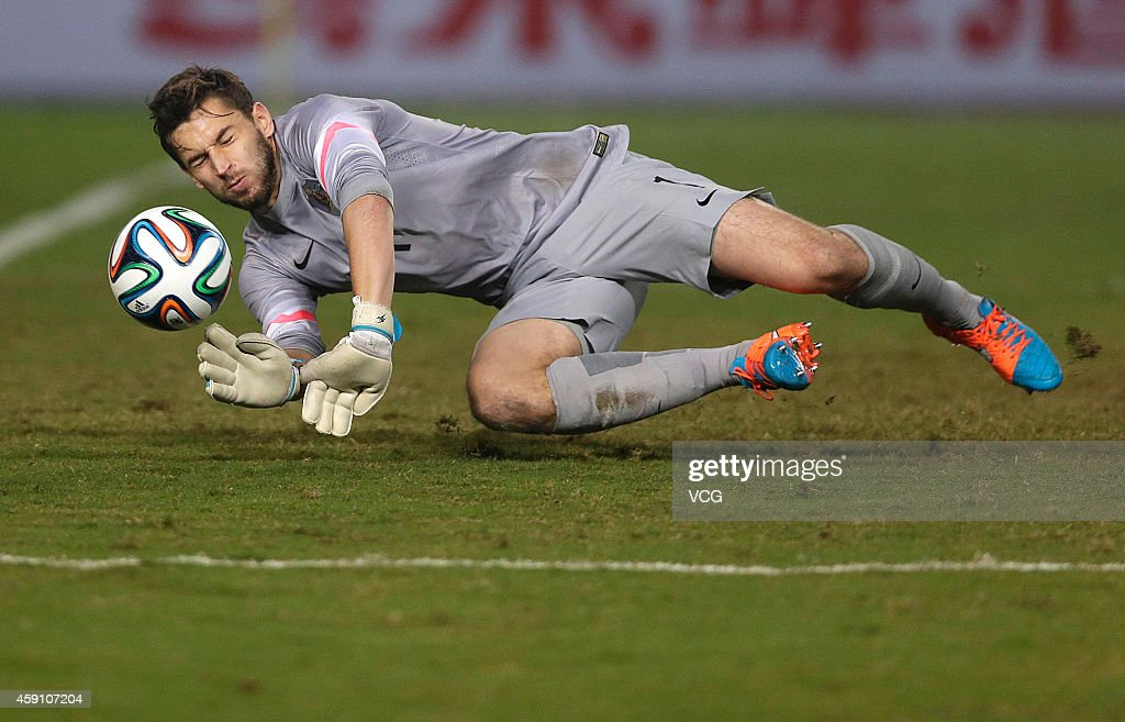 Aaron Lennox #1 of Australia saves the ball during the match between China U22 and Australia U22 on day three of the 'Wuhan City of Automobile' International Youth Football Tournament at Wuhan Sports Center Stadium on November 16, 2014 in Wuhan, China.