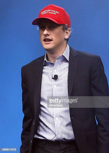 """Aaron Levie, chief executive officer and co-founder of Box Inc., arrives on stage wearing a hat reading """"Make Software Great Again"""" during the..."""