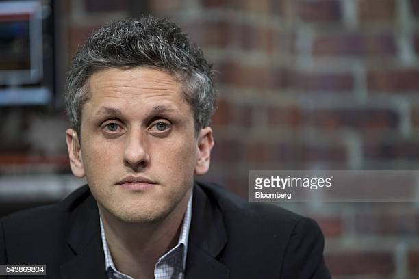 Aaron Levie, chief executive officer and co-founder of Box Inc., listens during a Bloomberg West television interview in San Francisco, California,...