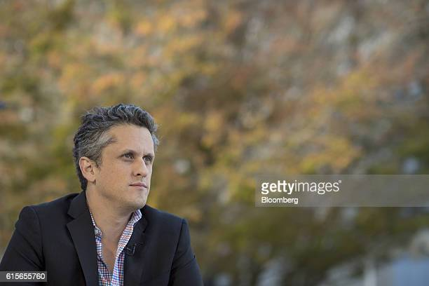 Aaron Levie, co-founder and chief executive officer of Box Inc., listens during a Bloomberg Television interview at the Vanity Fair New Establishment...