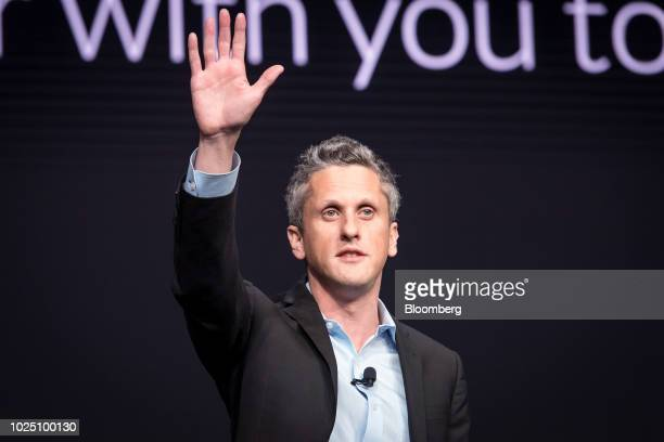 Aaron Levie, co-founder and chief executive officer of Box Inc., waves after speaking during the BoxWorks 2018 Conference at the Moscone Center in...